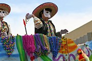 Маски и разноцветные бусы – основные атрибуты Mardi Gras. // iStockphoto