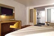 Все номера располагают рабочей зоной и пространствами, выполняющими функции кухни, гостиной и столовой. // marriott.co.uk