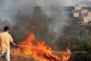 Огонь подбирается к столице. // Reuters