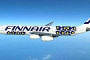 Лайнер, украшенный синими маками Marimekko. // Finnair