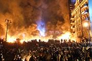 Киев интересует отважных туристов. // Sergei Grits / AP