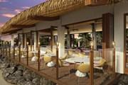 В отеле - пять ресторанов, в том числе - на пляже. // dusit.com